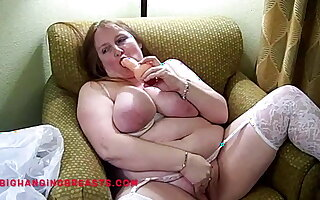 Busty Mature in white stockings with dildos