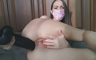 HOT MASKED NURSE EAGERLY STRETCHES HER ASS WITH BLACK DILDO
