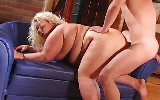 Fat mature lady works the big dick in a perfect doggy style