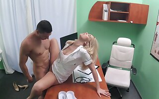 Hot babe has a young buck in her medical exam room and does what feels good
