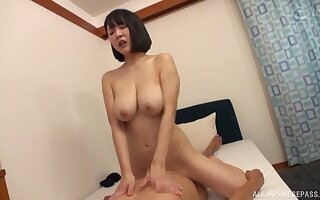 Things are pretty steamy for the busty Japanese mom