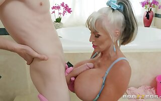 Busty mature tries a young dong up her thirsty mouth