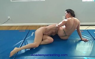 academywrestling.com  female fighting back scissors, arm bars, headlocks added to submissions as the loser is d to eat pussy