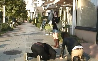 Smoking hot Japanese chick enjoys sucking duo cocks at the same time